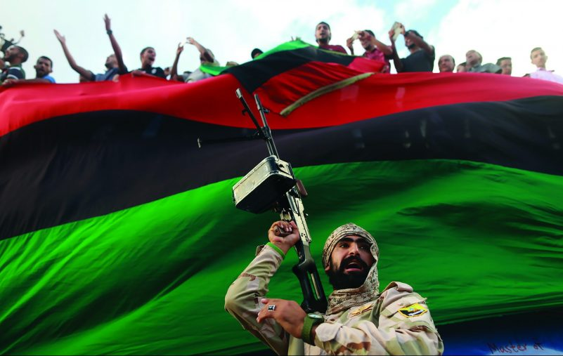 One of the members of the military protecting a demonstration against candidates for a national unity government proposed by U.N. envoy for Libya Bernardino Leon, is pictured in Benghazi, Libya October 23, 2015. REUTERS/Esam Omran Al-Fetori      TPX IMAGES OF THE DAY      - GF20000029968