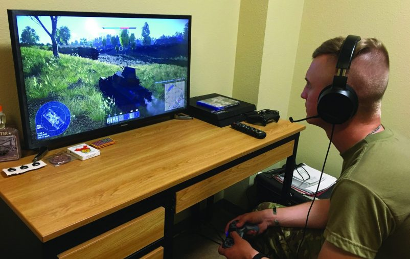 Sgt. David Ose, a section leader in D Troop, 6th Squadron, 9th Cavalry Regiment, 3rd Brigade Combat Team,1st Cavalry Division plays an online game that the unit is using to help maintain readiness while protecting the force. The Troop uses it to train on tactics, maneuver and communications. (Army photo by Capt. Mike Manougian)