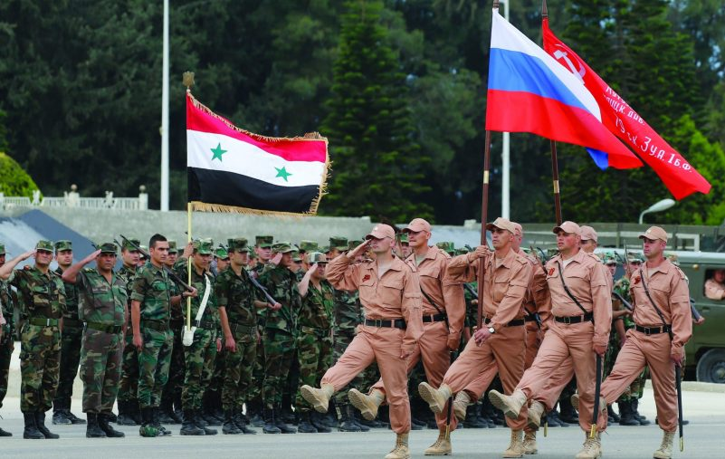 epa05290100 Russian soldiers march during a rehearsal of Victory Day parade, in which they will take part with a Syrian unit at Hmeimym airbase in Latakia province, Syria, 04 May 2016. Victory Day will be held on 09 May 2016 to mark the 71st anniversary since the capitulation of Nazi Germany to the Soviet Union. Hmeimym airbase serves as the base of operation for the Russian air force in Syria. The United States and Russia have agreed to extend the cease-fire in Syria to the city of Aleppo, the US State Department reported on 04 May.  EPA/SERGEI CHIRIKOV