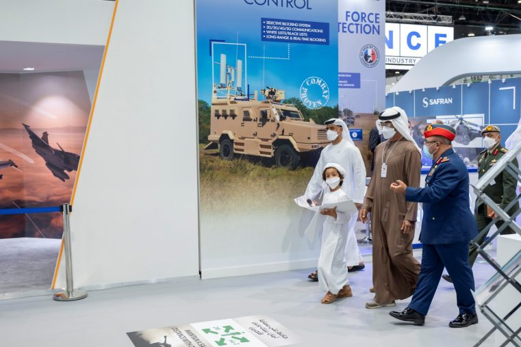 ABU DHABI, UNITED ARAB EMIRATES - February 24, 2021: HH Sheikh Mohamed bin Zayed Al Nahyan, Crown Prince of Abu Dhabi and Deputy Supreme Commander of the UAE Armed Forces (2nd R), tours the International Defence Exhibition and Conference (IDEX), at ADNEC. Seen with HH Sheikh Saif bin Nahyan bin Saif Al Nahyan (3rd R).   ( Mohamed Al Hammadi / Ministry of Presidential Affairs ) ---