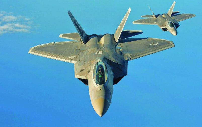 Two U.S. Air Force F-22 Raptors from the 95th Fighter Squadron, Tyndall Air Force Base, Fla., fly over the Baltic Sea, Sept. 4, 2015. The U.S. Air Force has deployed four F-22 Raptors, one C-17 Globemaster III, approximately 60 Airmen and associated equipment to Spangdahlem Air Base, Germany. While these aircraft and Airmen are in Europe, they will conduct air training with other Europe-based aircraft. (U.S. Air Force photo by Tech. Sgt. Jason Robertson/Released)