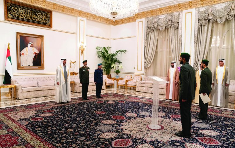 ABU DHABI, UNITED ARAB EMIRATES - February 17, 2020: HH General Sheikh Mohamed bin Zayed Al Nahyan Crown Prince of Abu Dhabi Deputy Supreme Commander of the UAE Armed Forces (L), witnesses the oath of a UAE military judiciary official during a swearing in ceremony for new military judges and prosecutors, during a Sea Palace barza. Seen with HE Lt General Hamad Thani Al Romaithi, Chief of Staff UAE Armed Forces (2nd L) and HE Brigadier General Salim Juma Al Kaabi, Director of Military Justice (3rd L).   ( Hamad Al Kaabi / Ministry of Presidential Affairs ) ---