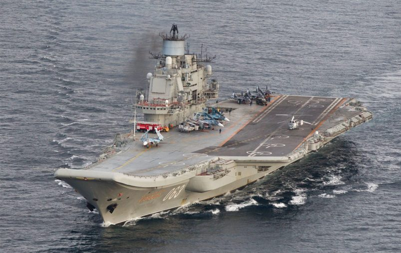 This October 17, 2016 Norwegian Armed Forces handout image shows the Russian aircraft carrier Admiral Kuznetsov passing the Norwegian island of Andoya in international waters on its way to the mediterranean. - The Admiral Kuznetsov aircraft carrier the nuclear powered  battleship Pyotr Velikiy and six other vessels were photographed by Norway' s Lockheed P-3 Orion surveillance aircraft. (Photo by STR / forsvaret / AFP) / RESTRICTED TO EDITORIAL USE - MANDATORY CREDIT