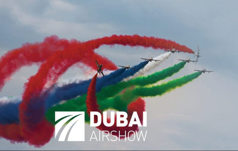 A,Group,Of,Aircraft,Performs,Aerobatics,Figure,In,The,Sky