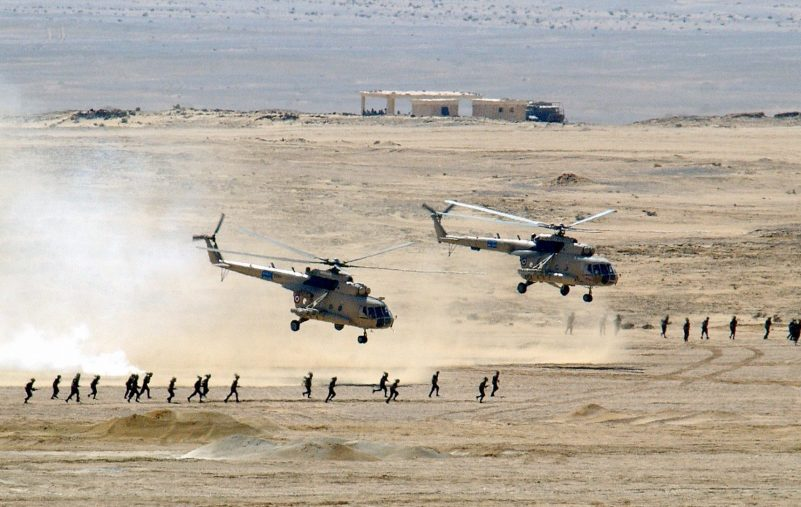 Two Soviet-made Egyptian Mi-8 Hip helicopters lift off after dropping of Egyptian Army Soldiers, at Mubarak Military City, as US, Spanish and Egyptian armed forces conduct amphibious assault operations during Exercise BRIGHT STAR 01/02. BRIGHT STAR 01/02 is a multinational exercise involving more than 74,000 troops from 44 countries that enhances regional stability and military-to-military cooperation among our key allies, and our regional partners. It prepares US Central Command to rapidly deploy and employ the forces needed to deter aggressors and, if necessary, fight and win side-by-side with our allies and regional partners.