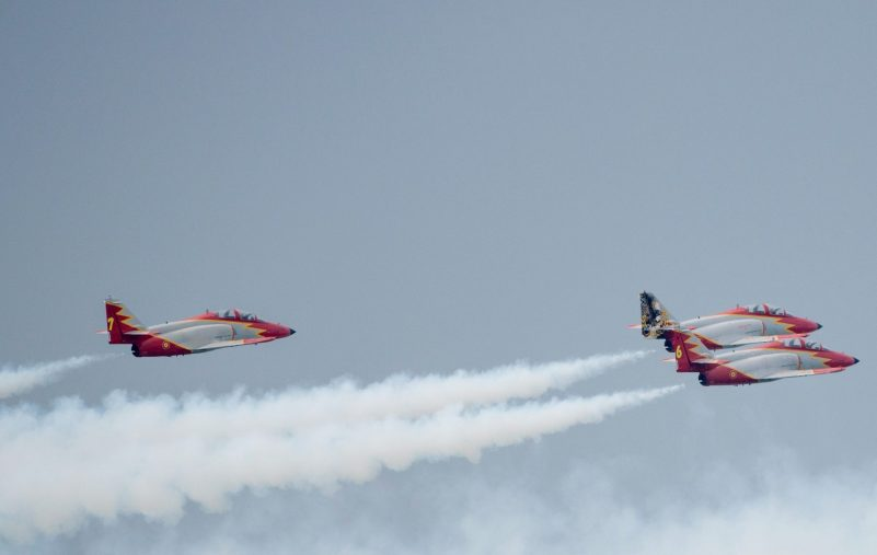 The Spanish patrol CASA C-101 aircrafts perform during an air show marking the French Air Forces 80th anniversary, on the military base of Cazaux, western France, on June 21, 2014. AFP PHOTO / FRED DUFOUR        (Photo credit should read FRED DUFOUR/AFP via Getty Images)