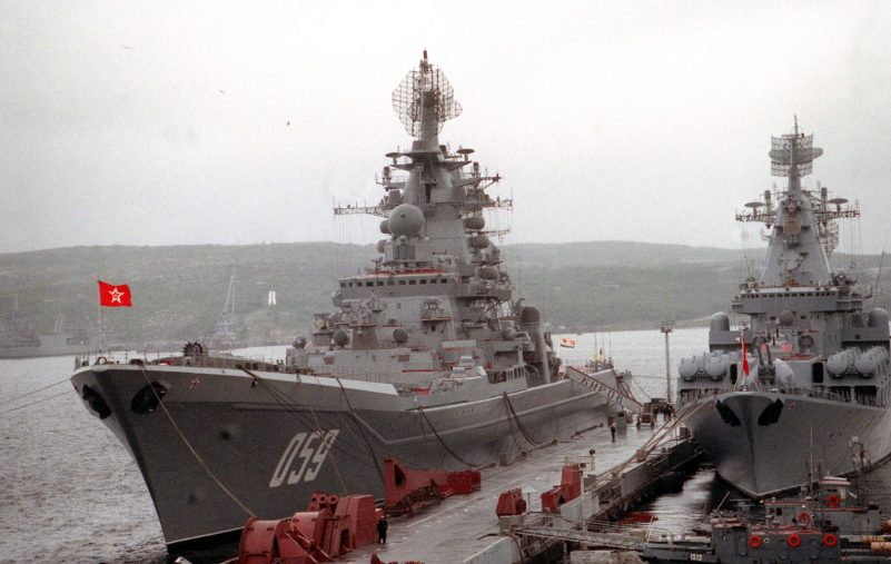 The Russian nuclear-powered guided missile cruiser ADMIRAL USHAKOV, left, still bearing its original name, KIROV, on the gangplank, and the guided missile cruiser MARSHAL USTINOV stand moored to a pier during a port call by two American ships.  The Guided missile cruiser USS YORKTOWN (CG-48) and the destroyer USS O'BANNON (DD-987) are visiting Severomorsk as part of an ongoing exchange between the navies of the United States and the Commonwealth of Independent States.