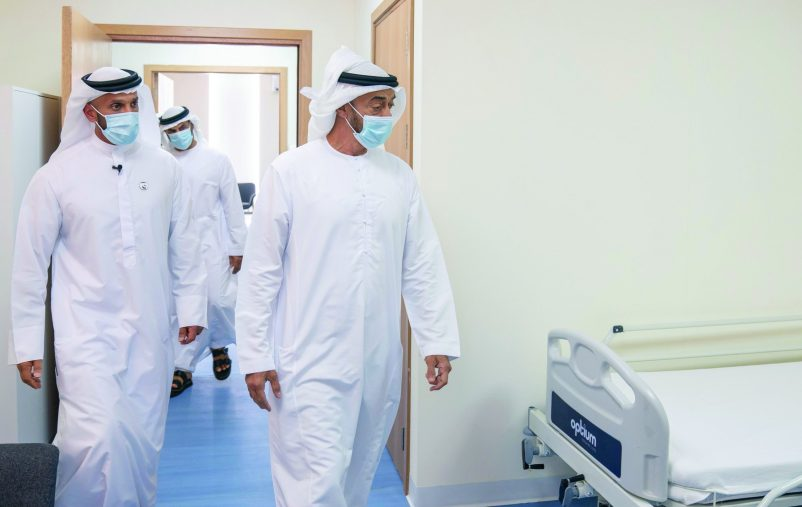 ABU DHABI, UNITED ARAB EMIRATES - May 18, 2020: HH Sheikh Mohamed bin Zayed Al Nahyan, Crown Prince of Abu Dhabi and Deputy Supreme Commander of the UAE Armed Forces (R) visits Emirates Field Hospital, at Emirates Humanitarian City. Seen with HE Sheikh Abdullah bin Mohammed Al Hamed, Chairman of the Department of Health - Abu Dhabi (L).  ( Hamad Al Mansoori for the Ministry of Presidential Affairs )​ ---