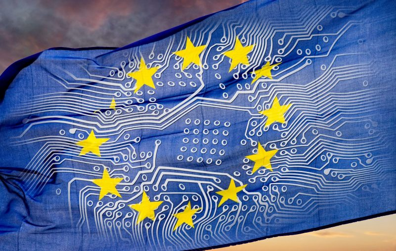 European,Flag,With,Board,In,Front,Of,Dramatic,Sky